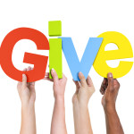 Diverse Hands Holding The Word Give